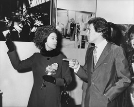 The Queen and Lord Snowdon discussing his pictures, Ideal Home Exhibition, Olympia, London, 1973. Artist: Unknown