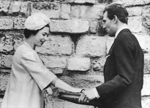 The Earl of Snowdon hands over the keys to Caernarvon Castle to Queen Elizabeth II, 1963. Artist: Unknown