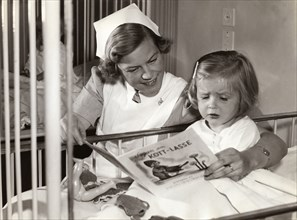 Nurse and her young patient at a children's hospital, Stockholm, Sweden, 1940s. Artist: Karl Sandels