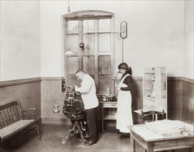 A dentist and his nurse give a schoolboy his treatment, 1910s. Artist: Unknown