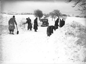 German/Italian prisoners of war clearing snow on Fairfield Common, Buxton, Derbyshire, 1947. Artist: JD Meddins