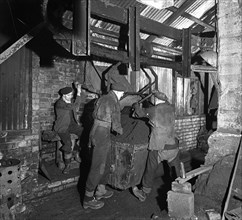 Miners working in Mitchell Main Colliery near Barnsley, South Yorkshire, 1956. Artist: Michael Walters