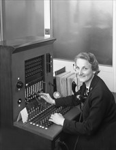 Switch board operator, Spillers Animal Foods, Gainsborough, Lincolnshire, 1960. Artist: Michael Walters