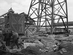 Installing a cage at Hickleton Main pit, Thurnscoe, South Yorkshire, 1961. Artist: Michael Walters