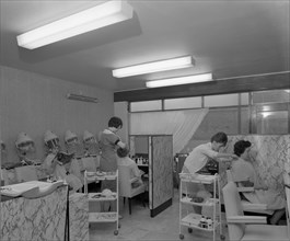 Hairdressers at work, Armthorpe, near Doncaster, South Yorkshire, 1961. Artist: Michael Walters