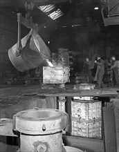 Teeming iron at Wombwell foundry, South Yorkshire, 1963. Artist: Michael Walters