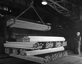 Steel 'H' girders being stacked for distribution, Park Gate, Rotherham, South Yorkshire, 1964. Artist: Michael Walters