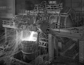 Pouring molten iron, Park Gate steelworks, Rotherham, South Yorkshire, 1964. Artist: Michael Walters