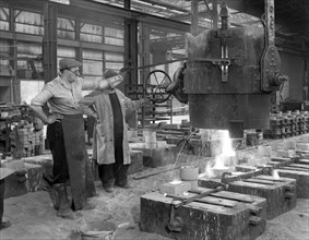Pouring a small casting at Edgar Allen's Steel foundry, Sheffield, South Yorkshire, 1963. Artist: Michael Walters