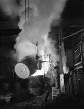 Teeming (pouring) molten iron at Edgar Allen's steel foundry, Sheffield, South Yorkshire, 1964. Artist: Michael Walters