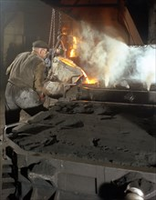 Pouring molten metal from a cupola into moulds, steel bath production, Hull, Humberside, 1965. Artist: Michael Walters