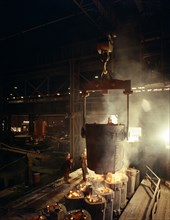 Teeming (pouring) molten iron, Brown Bayley Steels, Sheffield, South Yorkshire, 1968.  Artist: Michael Walters
