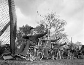 Archery practice at the CISWO paraplegic centre, Pontefract, West Yorkshire, 1960. Artist: Michael Walters