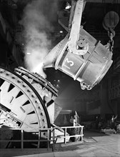 Pouring iron into a Kaldo unit, Park Gate Iron and Steel Co, Rotherham, South Yorkshire, 1964. Artist: Michael Walters