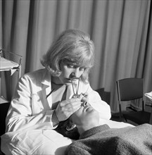 Medical eye checks, Rotherham General Infirmary, 1967. Artist: Michael Walters