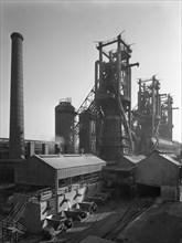 Molten steel being poured into rail trucks at the Stanton Steelworks, Ilkeston, Derbyshire, 1962. Artist: Michael Walters