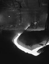 Molten steel being channelled at the Stanton Steel Works, Ilkeston, Derbyshire, 1962.  Artist: Michael Walters