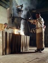 Teeming iron into ingots, J Beardshaw & Sons, Sheffield, South Yorkshire, 1963.  Artist: Michael Walters