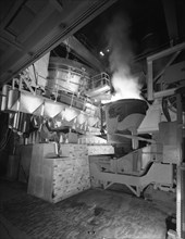 Steel pour from an electric arc furnace, Park Gate Iron & Steel Co, Rotherham, Yorkshire, 1964.  Artist: Michael Walters