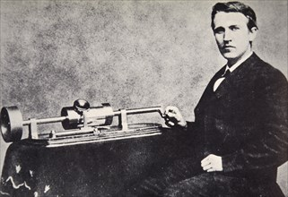 Thomas Alva Edison sitting beside his invention, the phonograph, 1878. Artist: Unknown