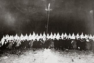 Ku Klux Klan initiation ceremony near Brunswick, Maryland, USA, c1920s(?). Artist: Unknown