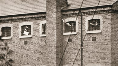Hunger strikers waving to Christabel Pankhurst from their cells in Holloway Prison, London, 1909. Artist: Unknown