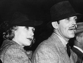 American film stars Clark Gable and Carol Lombard at a boxing match, c1936-1942. Artist: Unknown