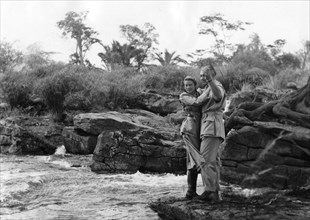 American actors Clark Gable and Grace Kelly filming at the Fourteen Waterfalls, Kenya, 1952. Artist: Unknown