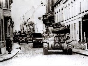 Polish tanks advance through the town of Tielt, Belgium, c1944. Artist: Unknown