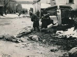 German troops stripping the equipment of dead American troops, Belgium. Artist: Unknown