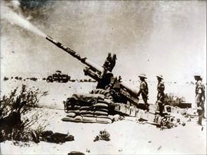 A British artillery piece in action, south of El Alamein, 1942. Artist: Unknown