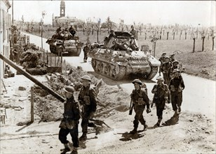 British 8th Army troops and tanks on the road to Ferrara, Italy, April 1945. Artist: Unknown