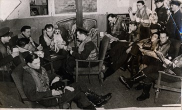 Typhoon pilots in their disperal hut, 12th April 1943. Artist: Unknown