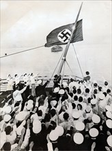 A salute to the Nazi party flag on the SS Bremen, New York, c1935. Artist: Unknown