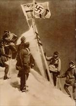 German Wehrmacht plant a Nazi flag on the summit of Mount Elbrus. Artist: Unknown