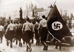 German troops enter Prague over the Charles Bridge, 15th March 1939. Artist: Unknown