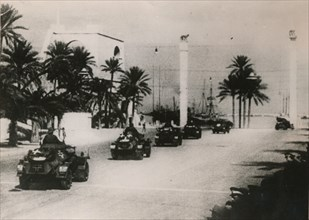 German armoured cars of a Panzer unit drive through Tripolie, West Libya, c.1943.. Artist: Unknown