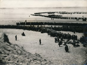 British and French troops wait on the dunes to be evacuated, Dunkirk, 1940. Artist: Unknown