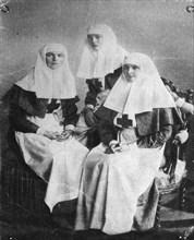 Tsarina Alexandra and Grand Duchesses Olga and Tatiana of Russia, 1914. Artist: Unknown