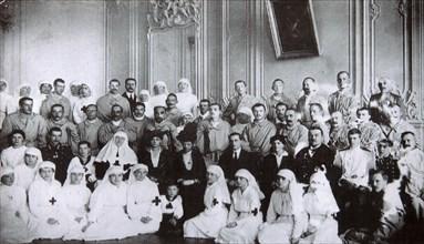 Tsarina Maria Fyodorovna of Russia visiting a hospital in Kiev, 1915. Artist: Unknown