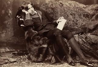 Oscar WiIde, Irish writer, wit and playwright, 1882. Artist: Napoleon Sarony
