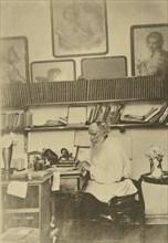Russian author Leo Tolstoy at work, 1890s. Artist: Sophia Tolstaya