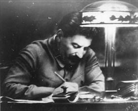 Soviet leader Josef Stalin in his Kremlin study, Moscow, USSR, 1935. Artist: Unknown