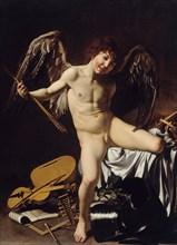 Cupid as Victor, ca 1601. Artist: Caravaggio, Michelangelo (1571-1610)