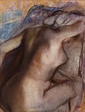 After the Bath, Woman Drying Herself. Artist: Degas, Edgar (1834-1917)
