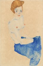 Sitting young woman, half nude with blue skirt (Wally Neuzil).