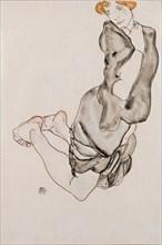 Kneeling Woman with a Gray Cape (Wally Neuzil), 1912.