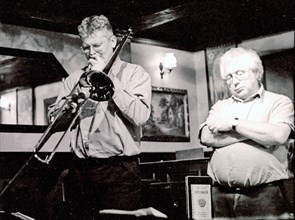 Mark Nightingale and Henry Lowther, Watermill, Dorking, Surrey, 2000. Artist: Brian O'Connor