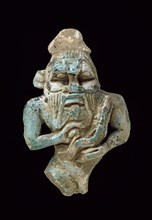Faience amulet of Bes nursing a Horus, XXVth Dynasty (c770 BC-c715 BC). Artist: Unknown.