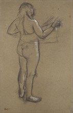 Nude Woman drying herself with a Towel, seen from behind, late 19th century. Artist: Edgar Degas.